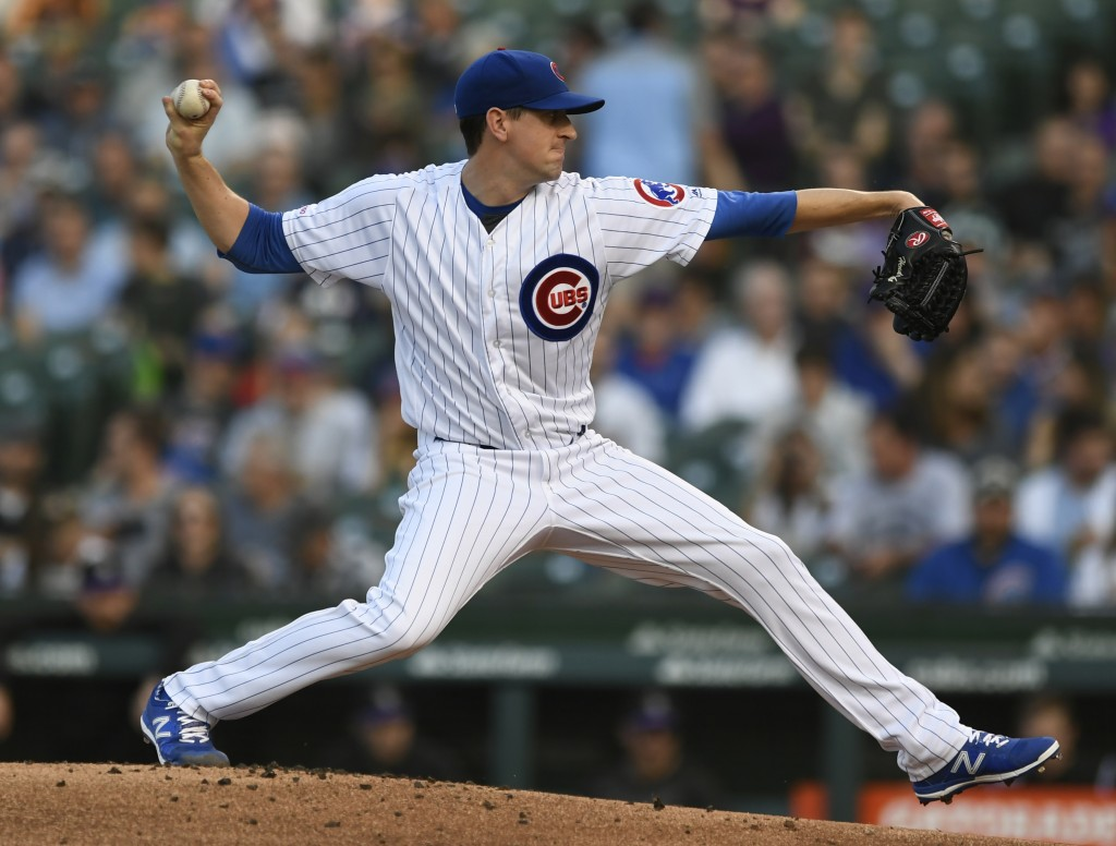Chicago Cubs starter Kyle Hendricks delivers a pitch during the first inning of a baseball game against the Colorado Rockies Tuesday, June 4, 2019, in...