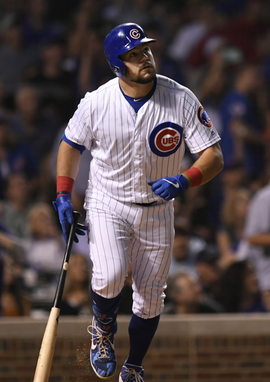 Chicago Cubs' Kyle Schwarber watches his solo home run during the fifth inning of a baseball game against the Colorado Rockies Tuesday, June 4, 2019, ...