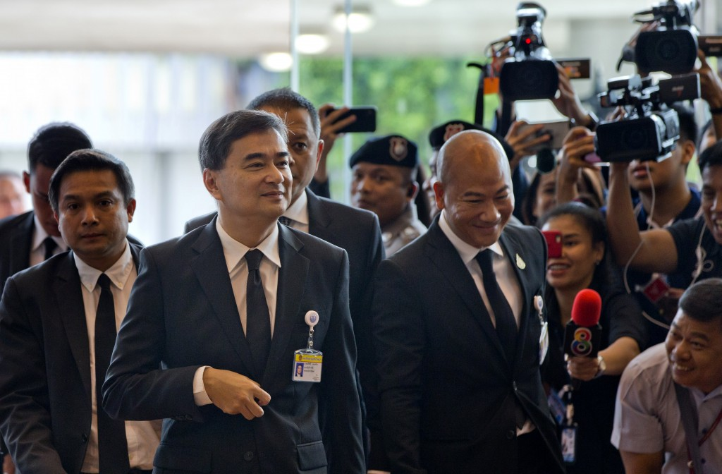 Former leader of Thailand's Democratic Party Abhisit Vejjajiva arrives to participate in the session in the parliament in Bangkok, Thailand, Wednesday...