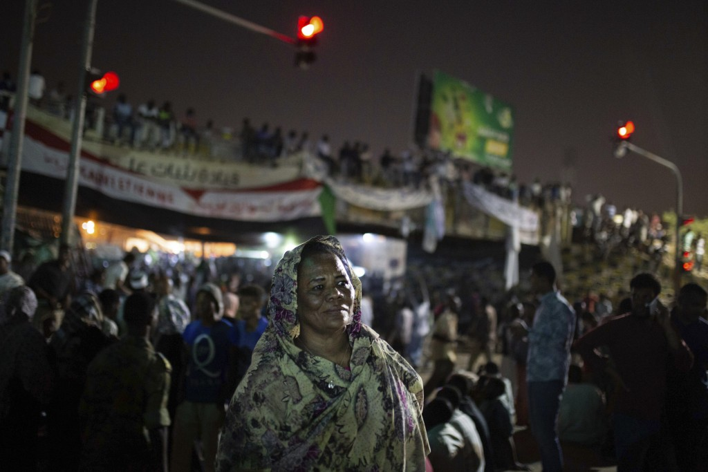 FILE -  In this Thursday, April 18, 2019 photo, Amal al-Zein, an activist who was detained under former Sudanese President Omar al-Bashir, attends a p...