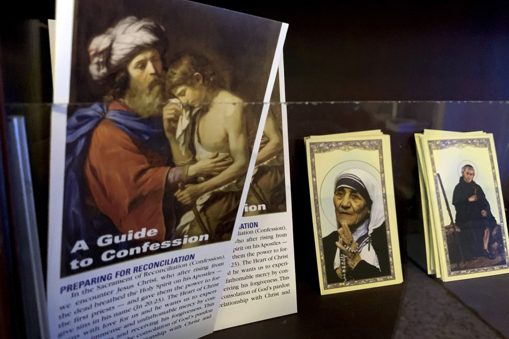 Religious cards are displayed on a wall at St. Michael Archangel Catholic Church in Houston, April 13, 2019. The church, which has been grappling for ...