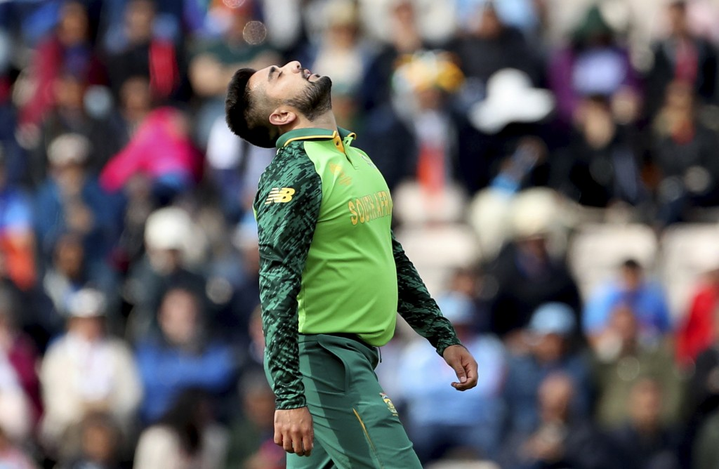 South Africa's Tabraiz Shamsi reacts after bowling a delivery to India's MS Dhoni during the Cricket World Cup match between South Africa and India at...