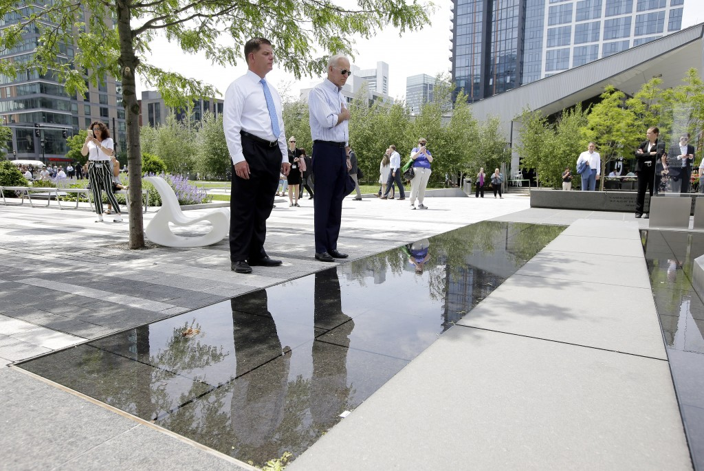 Former vice president and Democratic presidential candidate Joe Biden, right, pauses with Boston Mayor Marty Walsh, left, at a memorial to fallen serv...