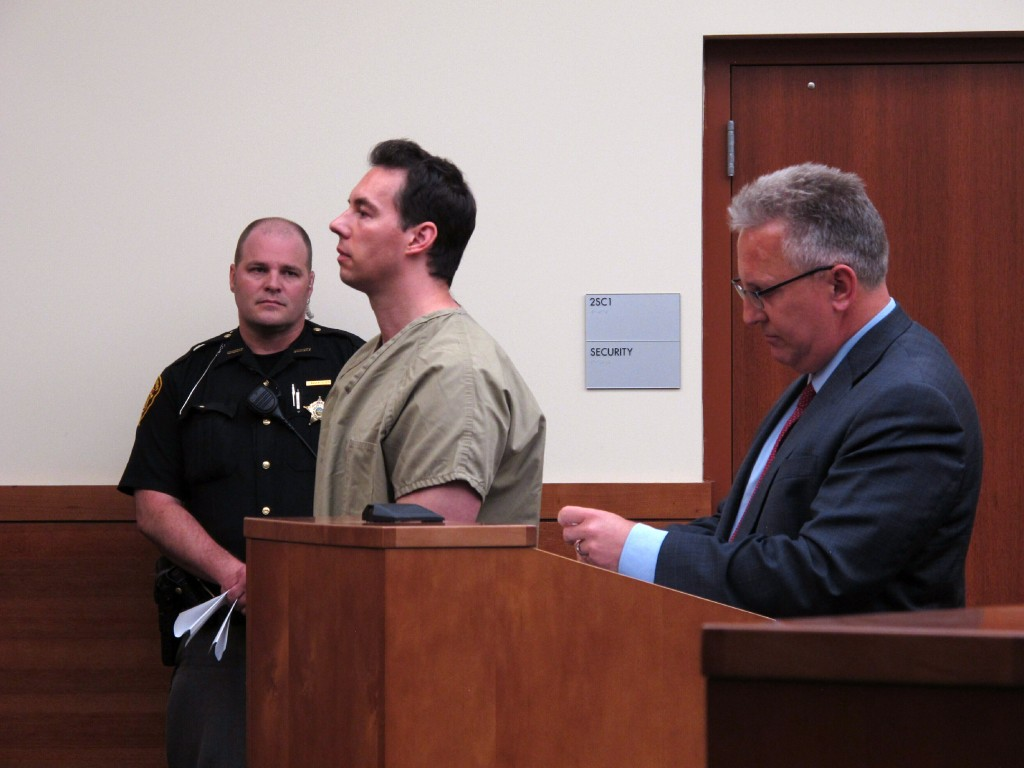 Former critical care doctor William Husel, center, pleads not guilty to murder charges in the deaths of 25 hospital patients while appearing with defe...