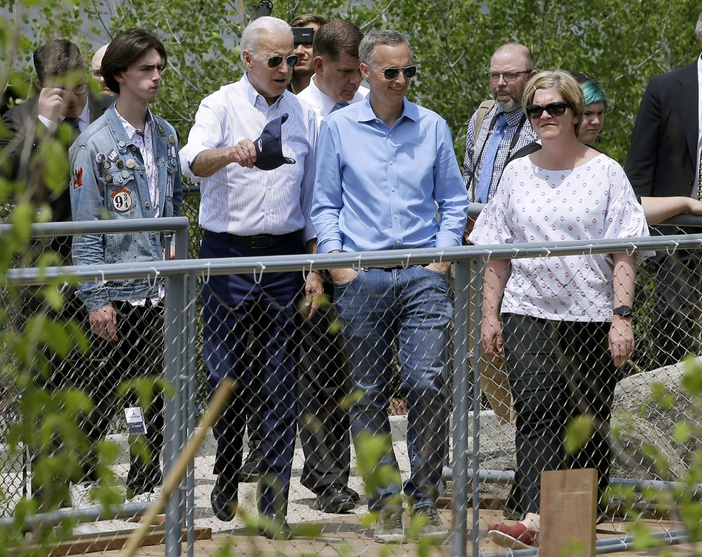 Former vice president and Democratic presidential candidate Joe Biden, second from left, views a park in Boston on Wednesday, June 5, 2019, with Bill
