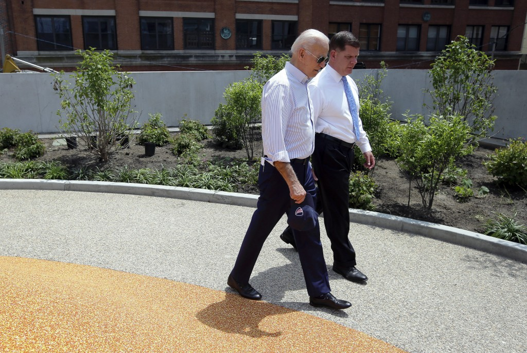 Former vice president and Democratic presidential candidate Joe Biden walks on Wednesday, June 5, 2019, beside Boston Mayor Marty Walsh, right, in a p...
