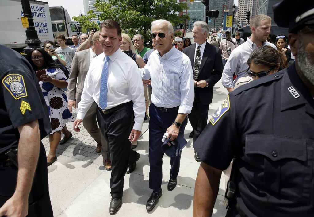Former vice president and Democratic presidential candidate Joe Biden walks with Boston Mayor Marty Walsh, left, on Wednesday, June 5, 2019, in downto