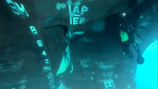 This undated photograph from the United Arab Emirates' Mission to the United Nations released Thursday, June 6, 2019, shows a diver investigating the ...