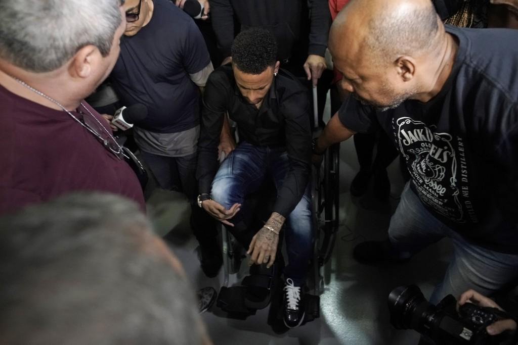Brazilian soccer player Neymar arrives to a police station, in a wheelchair due to an ankle injury, in Rio de Janeiro, Brazil, Thursday, June 6, 2019....