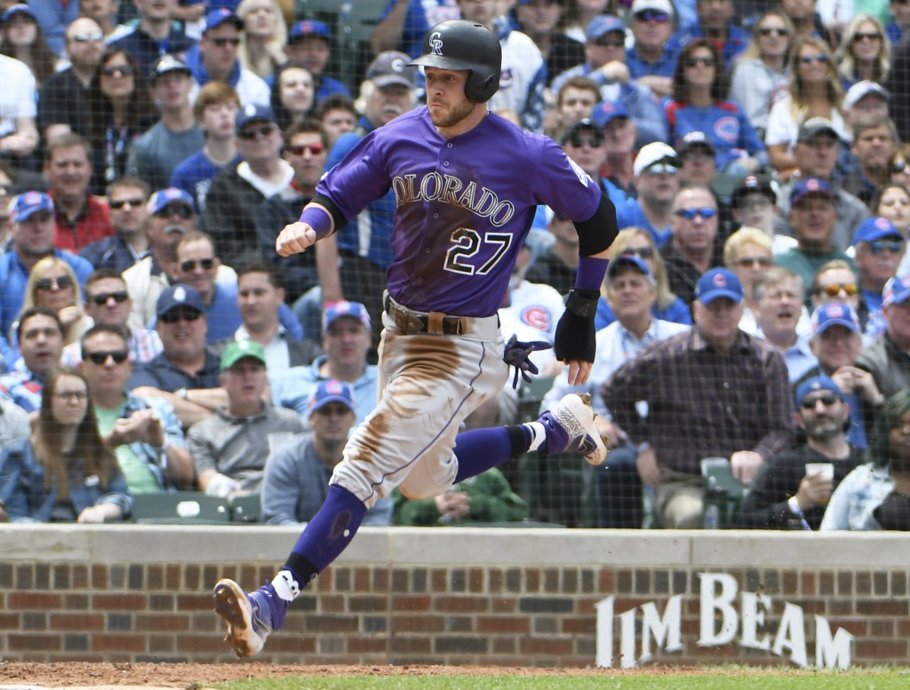 Colorado Rockies' Trevor Story (27) scores against the Chicago Cubs during the fourth inning of a baseball game, Thursday, June, 6, 2019, in Chicago. ...