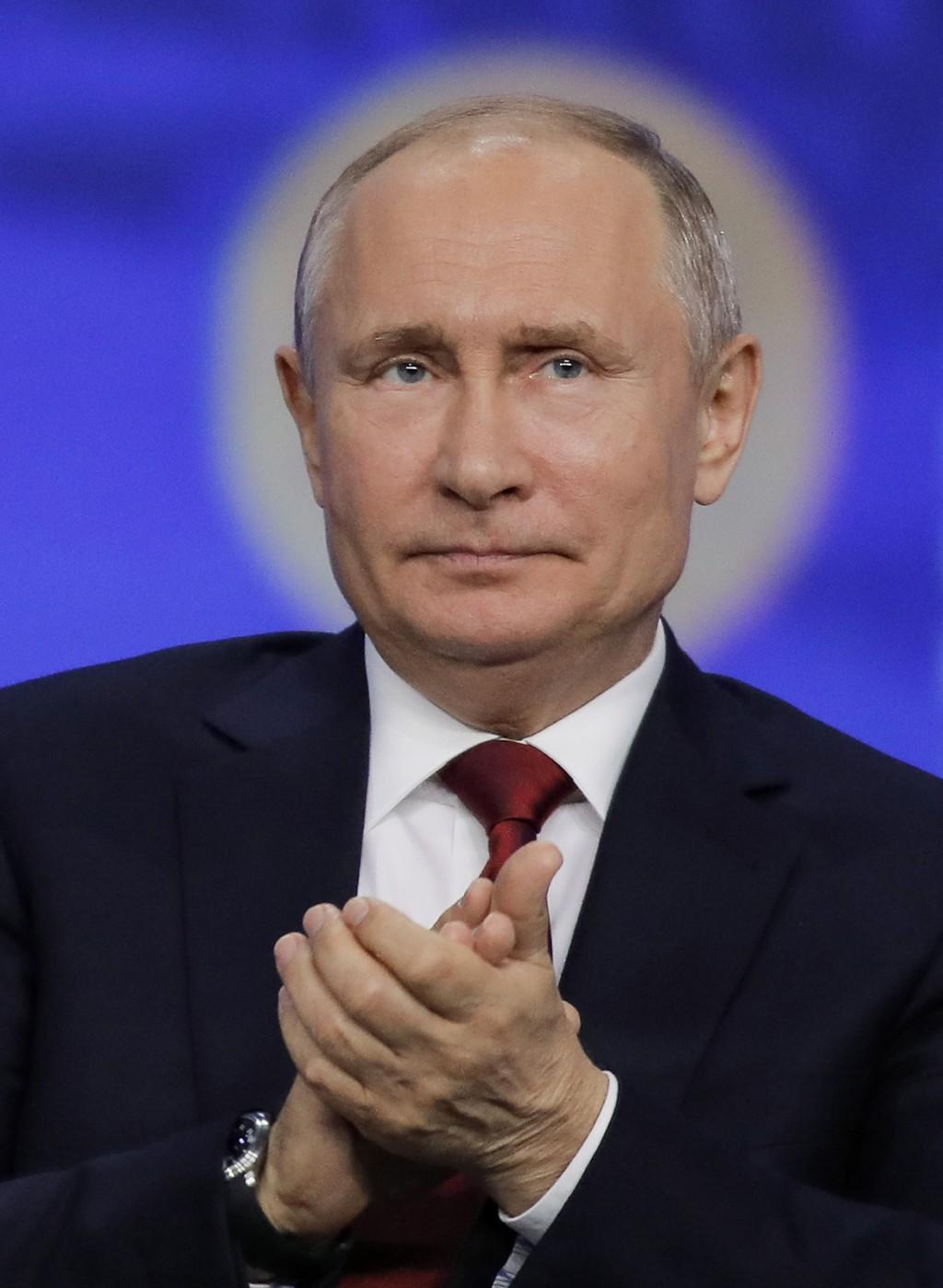 Russian President Vladimir Putin attends the St. Petersburg International Economic Forum in St. Petersburg, Russia, Friday, June 7, 2019. (AP Photo/Dm...