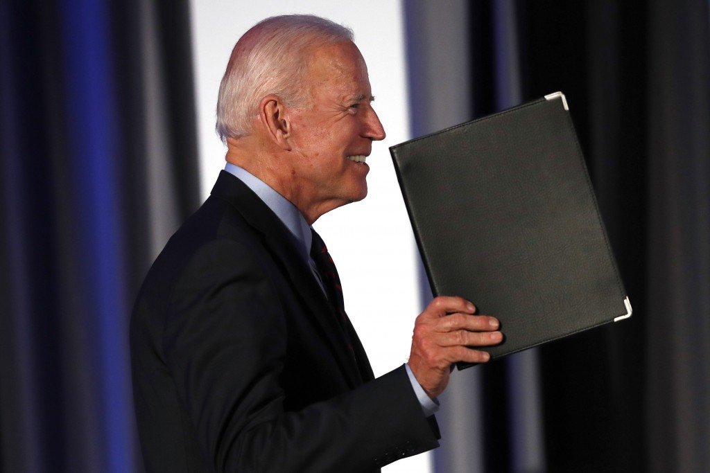 Democratic presidential candidate former Vice President Joe Biden gestures as he steps on stage before speaking during the I Will Vote Fundraising Gal...