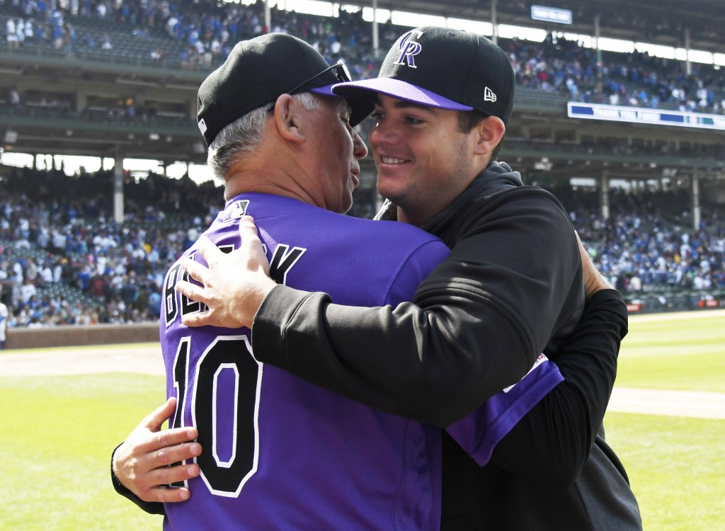 Colorado Rockies starting pitcher Peter Lambert, right, gets hug from Colorado Rockies manager Bud Black (10) after getting his first major league win...