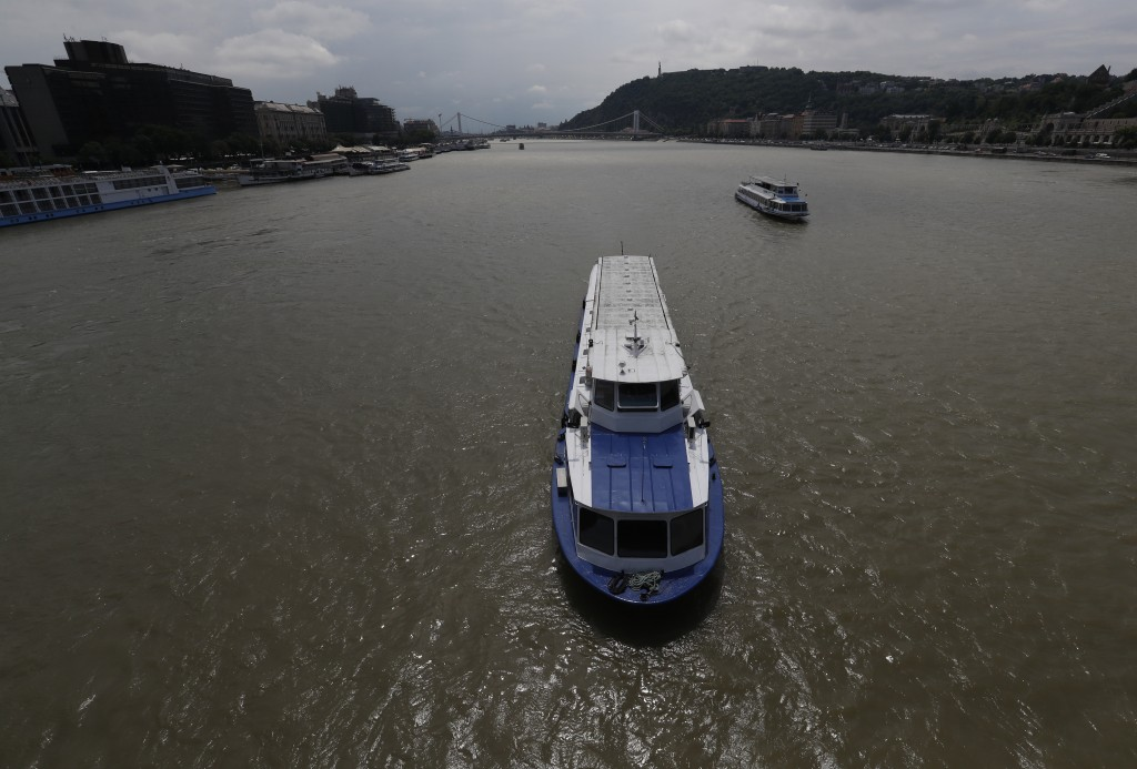 This photo taken on Wednesday, June 5, 2019 shows a downstream view from the Chain Bridge of tour boats on the Danube River in Budapest, Hungary. A to...