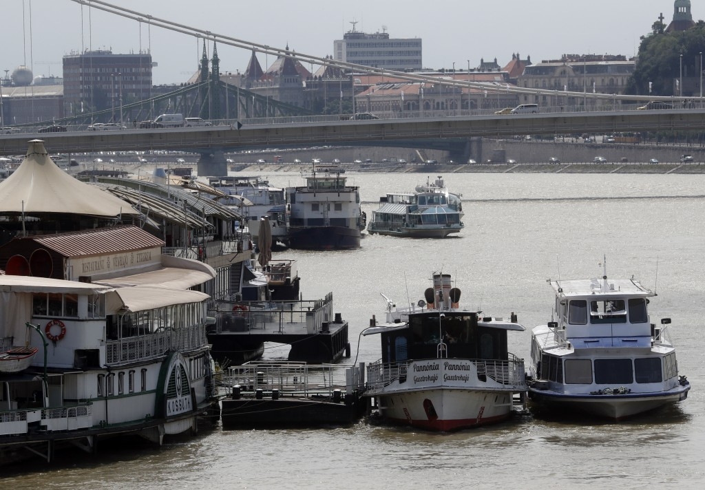 In this photo taken on Wednesday, June 5, 2019, restaurant and tour boats are docked on the Danube River near the Elizabeth Bridge in Budapest. A tour...