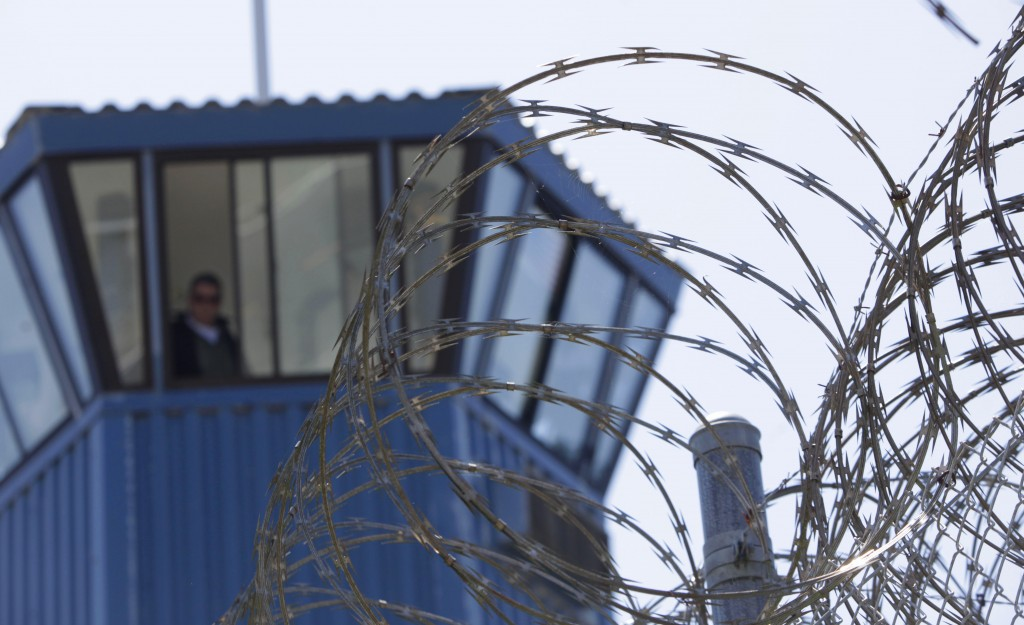 FILE - In this Aug. 17, 2011, file photo, concertina wire and a guard tower are seen at Pelican Bay State Prison near Crescent City, Calif. Federal pr...