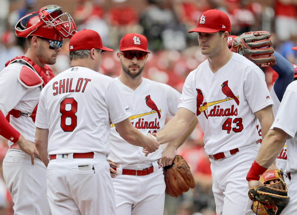 St. Louis Cardinals starting pitcher Dakota Hudson (43) is removed by manager Mike Shildt (8) during the seventh inning of a baseball game against the...