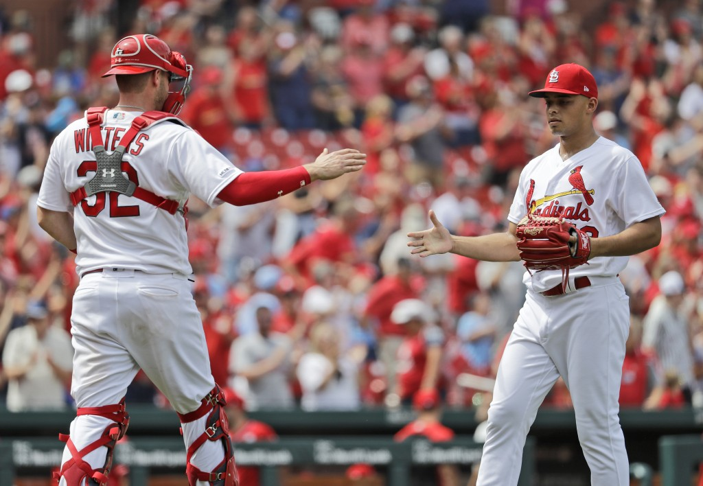 St. Louis Cardinals relief pitcher Jordan Hicks, right, and catcher Matt Wieters celebrate after a 3-1 victory over the Cincinnati Reds in a baseball