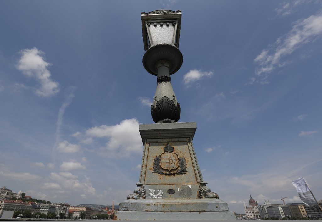 In this photo taken on Wednesday, June 5, 2019, a lamp on the Chain Bridge over the Danube River in Budapest. A tourism boom in the Hungarian capital ...