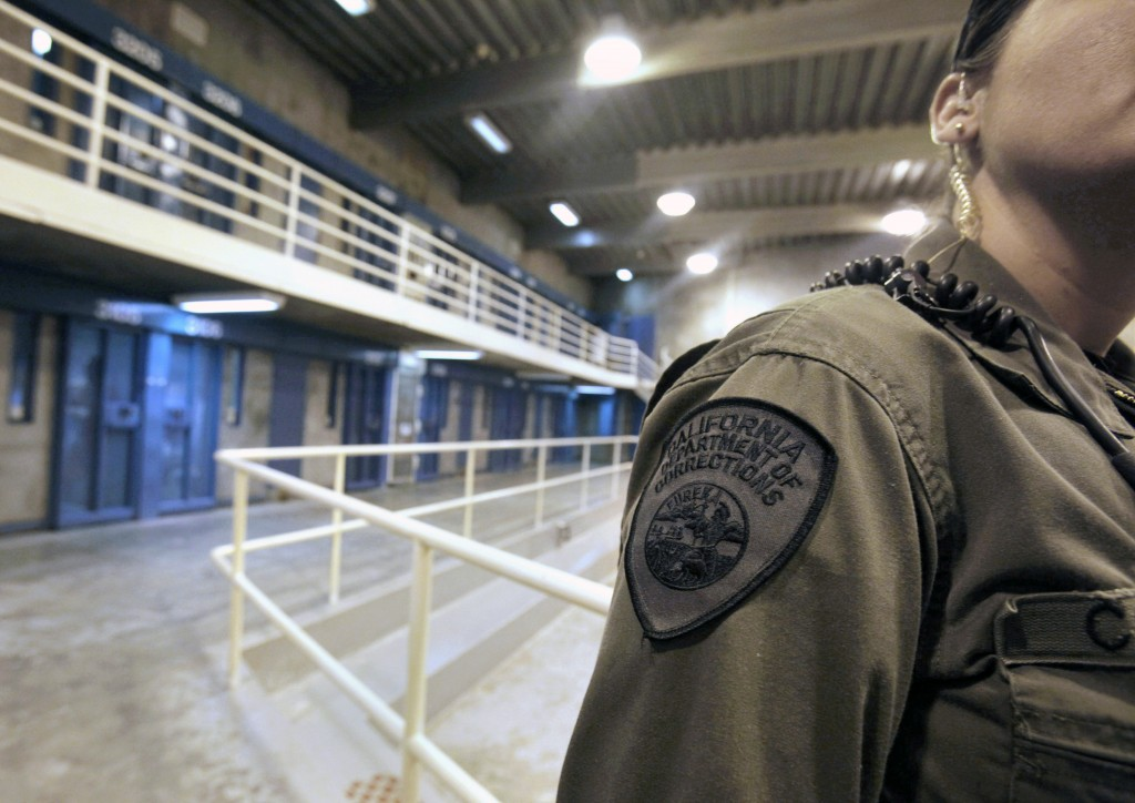 FILE - In this Aug. 17, 2011, file photo, a correctional officer works at one of the housing units at Pelican Bay State Prison near Crescent City, Cal...
