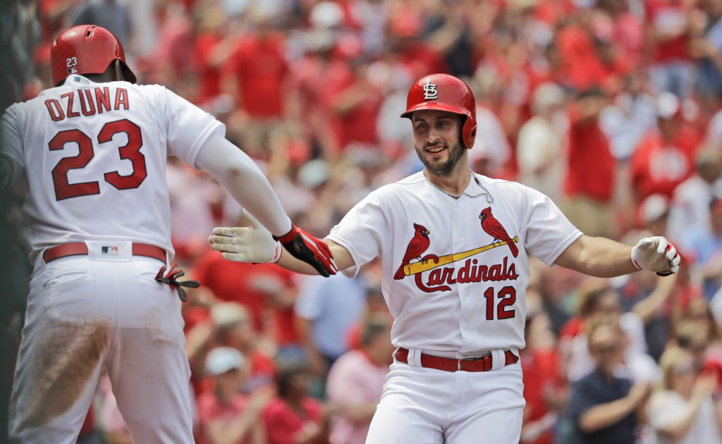 St. Louis Cardinals' Paul DeJong (12) is congratulated by teammate Marcell Ozuna (23) after hitting a two-run home run during the seventh inning of a ...