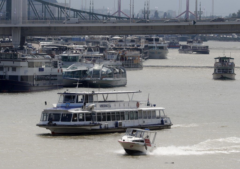In this photo taken on Wednesday, June 5, 2019, sightseeing, restaurant and tour boats are seen on the Danube River near the Elizabeth Bridge in Budap...