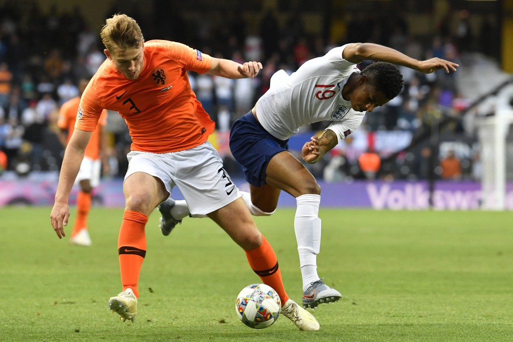 Netherlands' Matthijs de Ligt, left, fights for the ball with England's Marcus Rashford during the UEFA Nations League semifinal soccer match between