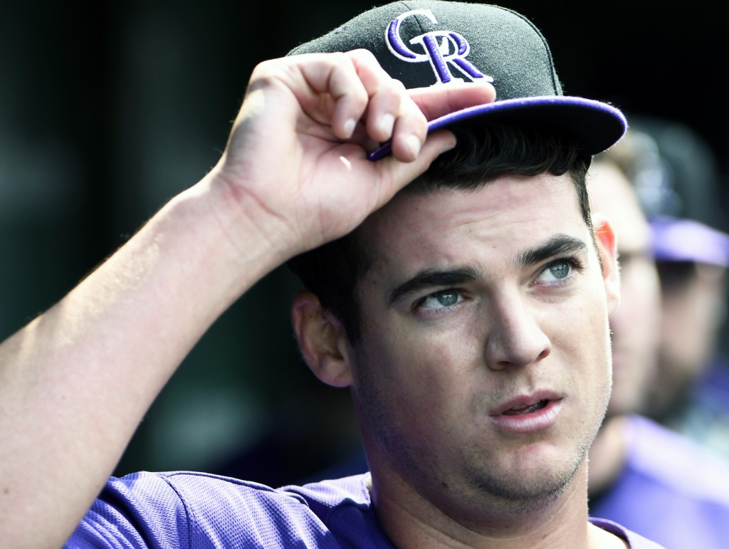Colorado Rockies starting pitcher Peter Lambert (23) gestures in the dugout after completing the seventh inning of a baseball game against the Chicago...