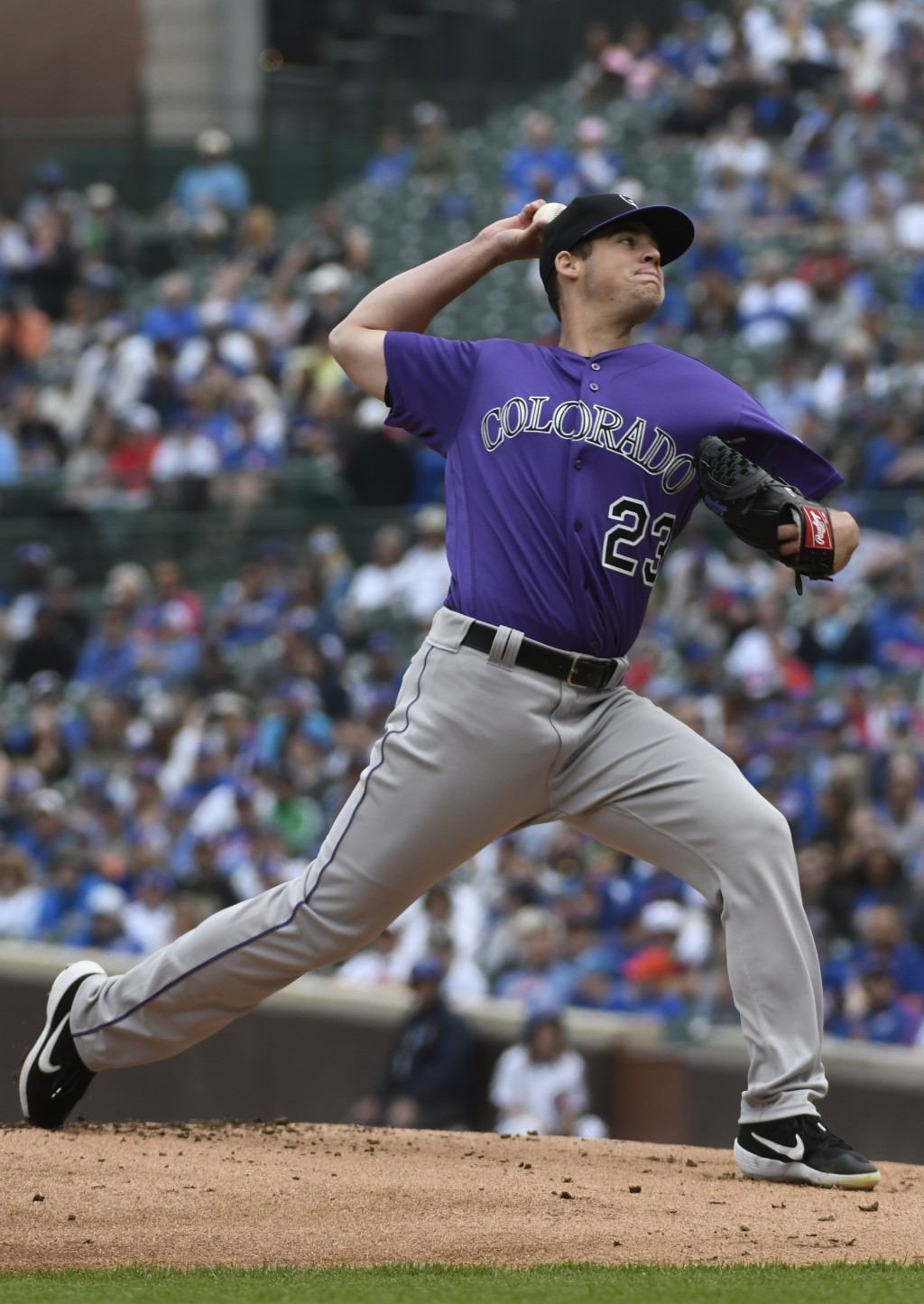 Colorado Rockies starting pitcher Peter Lambert (23) delivers against the Chicago Cubs during the first inning of a baseball game, Thursday, June, 6, ...