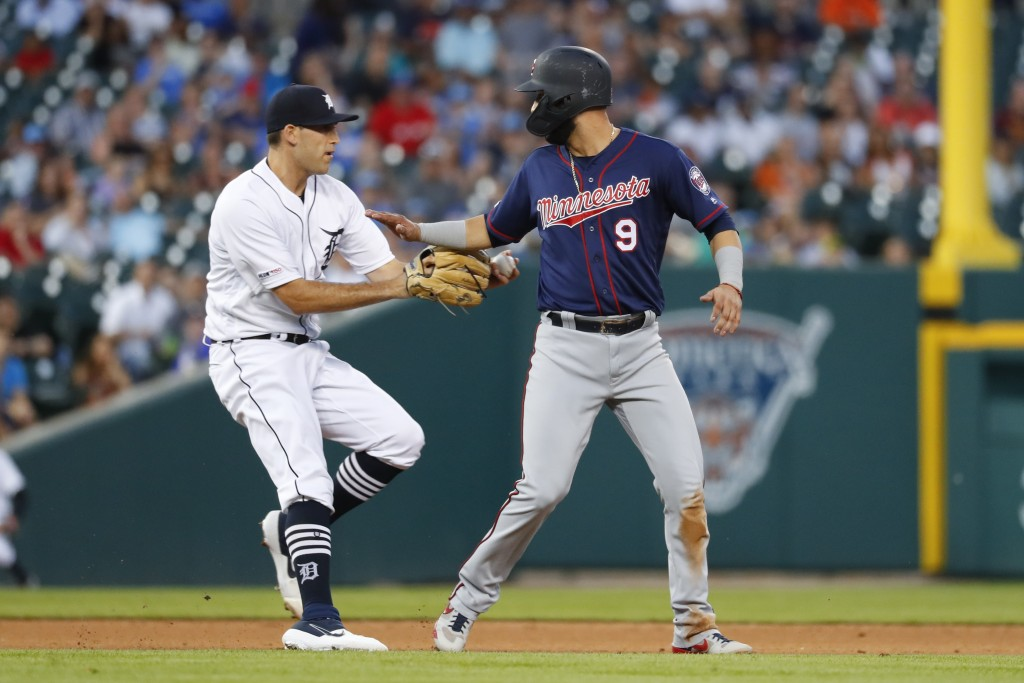 Detroit Tigers pitcher Matthew Boyd tags Minnesota Twins' Marwin Gonzalez (9) out during rundown at third base in the sixth inning of a baseball game