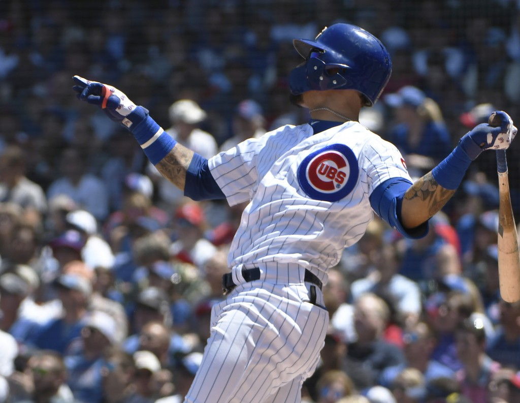 Chicago Cubs' Javier Baez (9) hits a two run home run against the St. Louis Cardinals during the first inning of a baseball game, Friday, June, 7, 201...