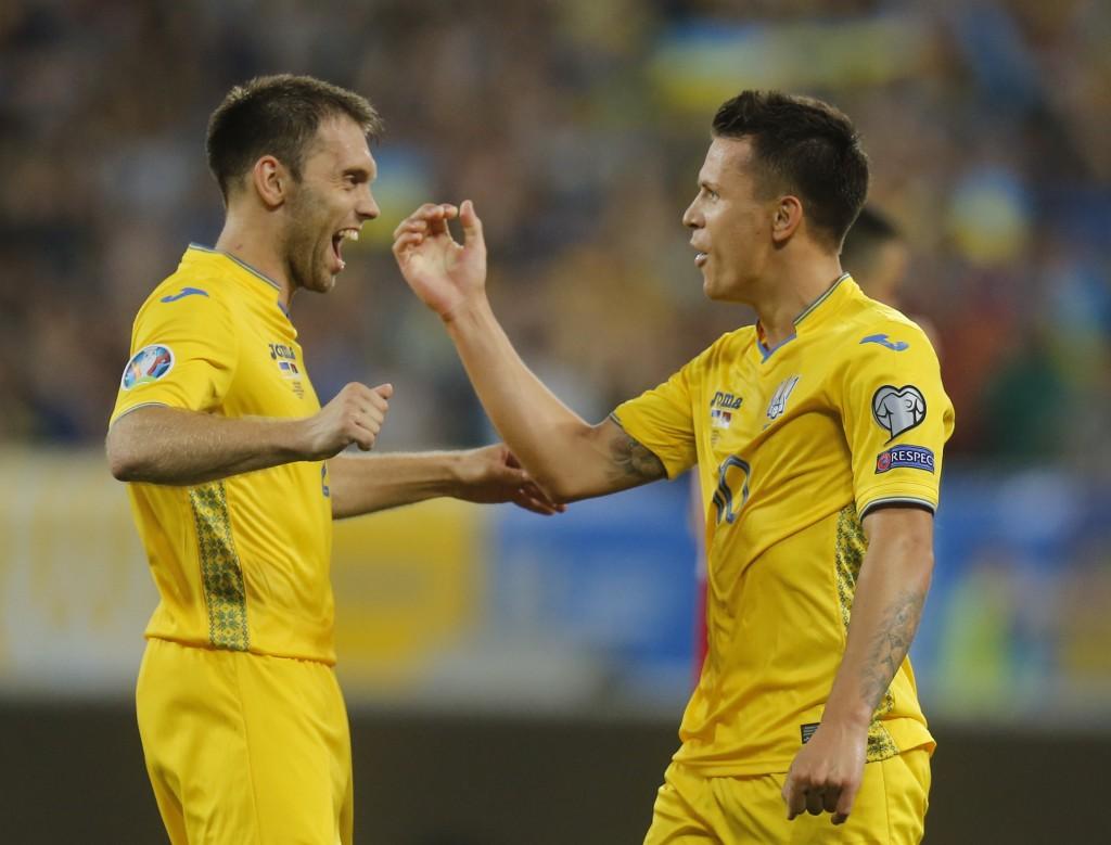 Ukraine's Yevhen Konoplyanka, right, celebrates after scoring his side's third goal with Ukraine's Oleksandr Karavaev during the Euro 2020 group B qua...