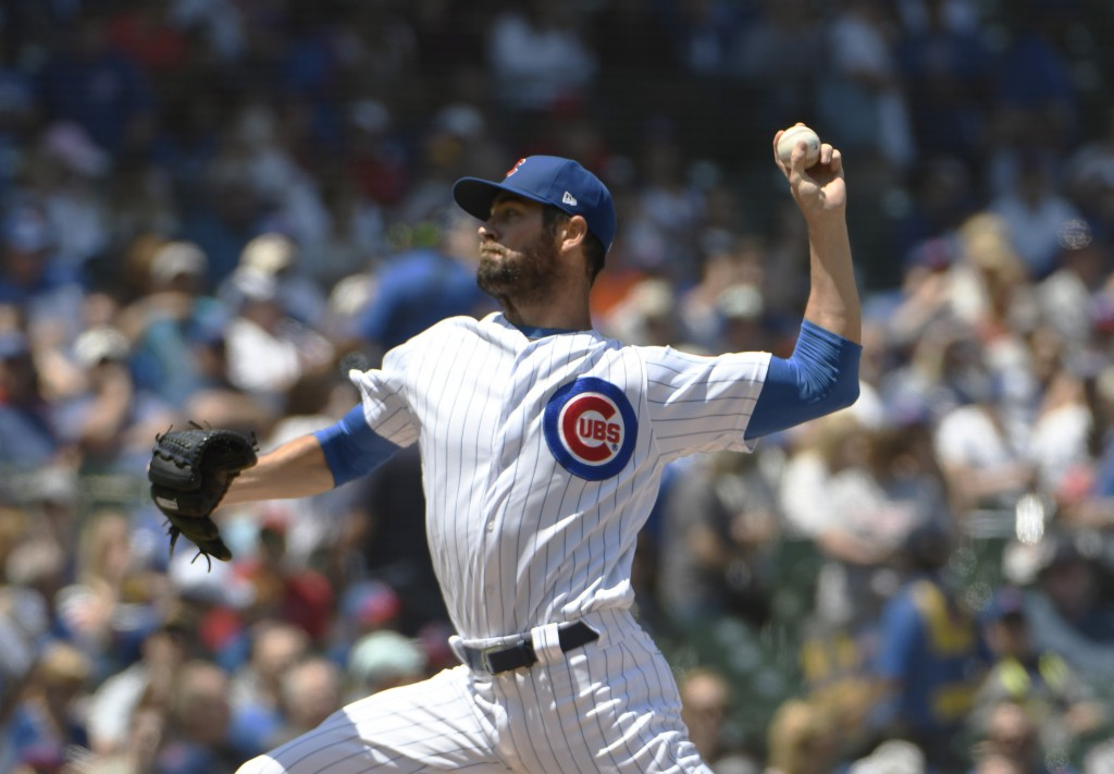 Chicago Cubs starting pitcher Cole Hamels (35) delivers against the St. Louis Cardinals during the first inning of a baseball game, Friday, June, 7, 2
