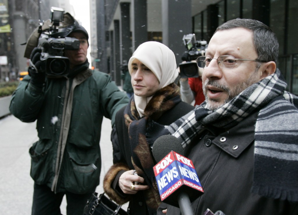 FILE - In this Feb. 1, 2007 file photo, Abdelhaleem Ashqar is surrounded by cameramen as he leaves federal court with his wife, in Chicago. Ashquar wh