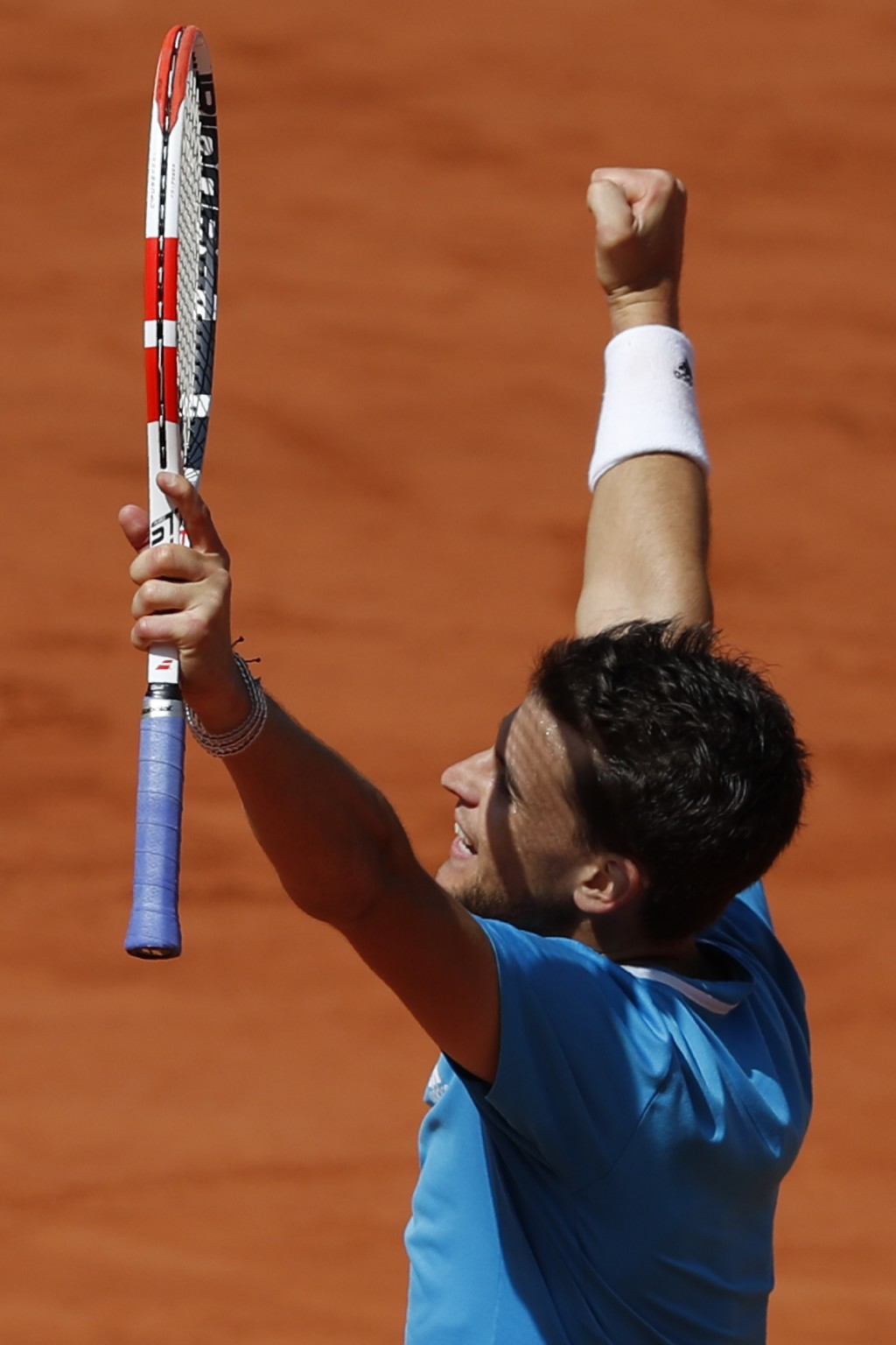 Austria's Dominic Thiem clenches his fist as he defeats Serbia's Novak Djokovic in their men's semifinal match of the French Open tennis tournament at...