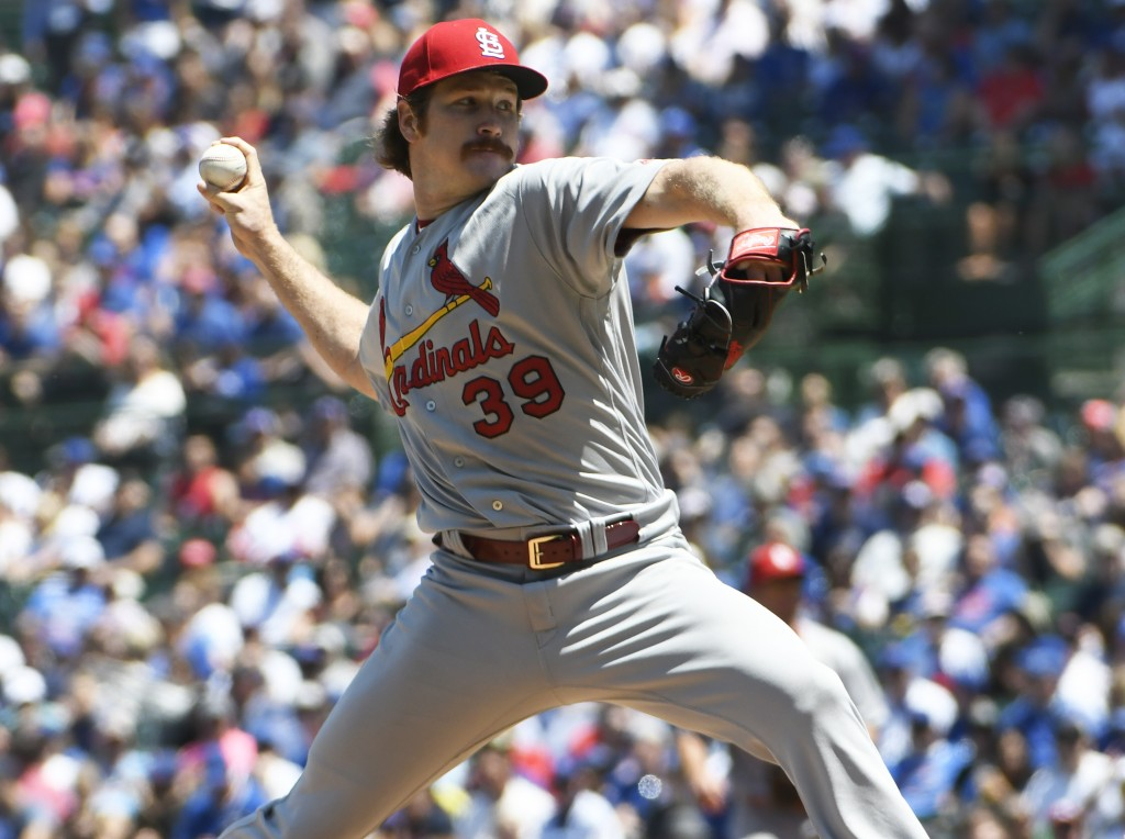 St. Louis Cardinals starting pitcher Miles Mikolas (39) delivers against the Chicago Cubs during the first inning of a baseball game, Friday, June, 7,