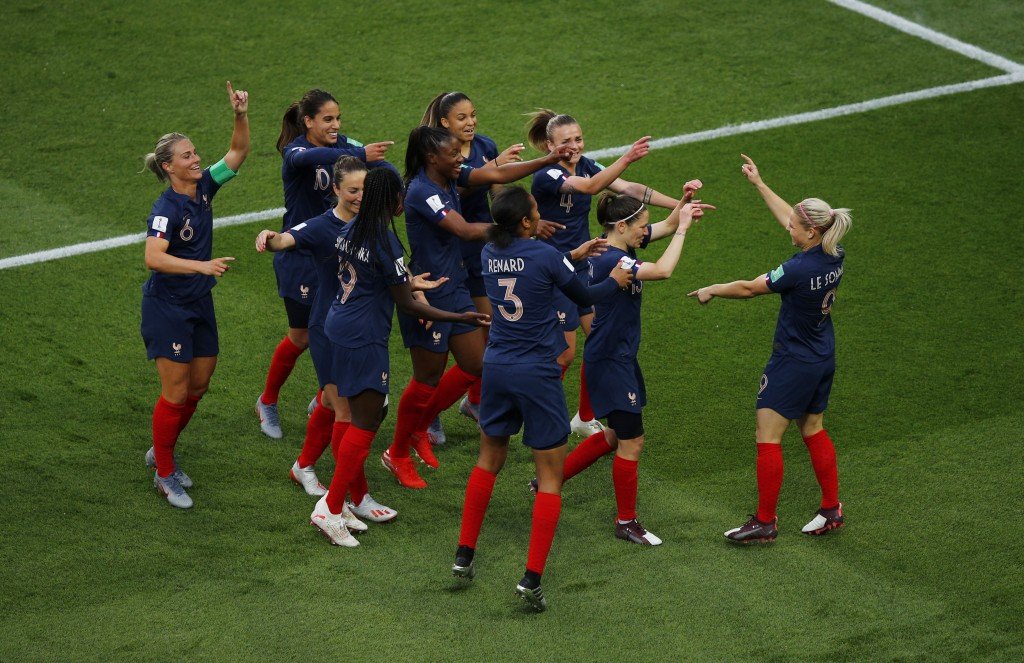 France's Eugenie Le Sommer, right, celebrates with her teammates after scoring her side's opening goal during the Women's World Cup Group A soccer mat...