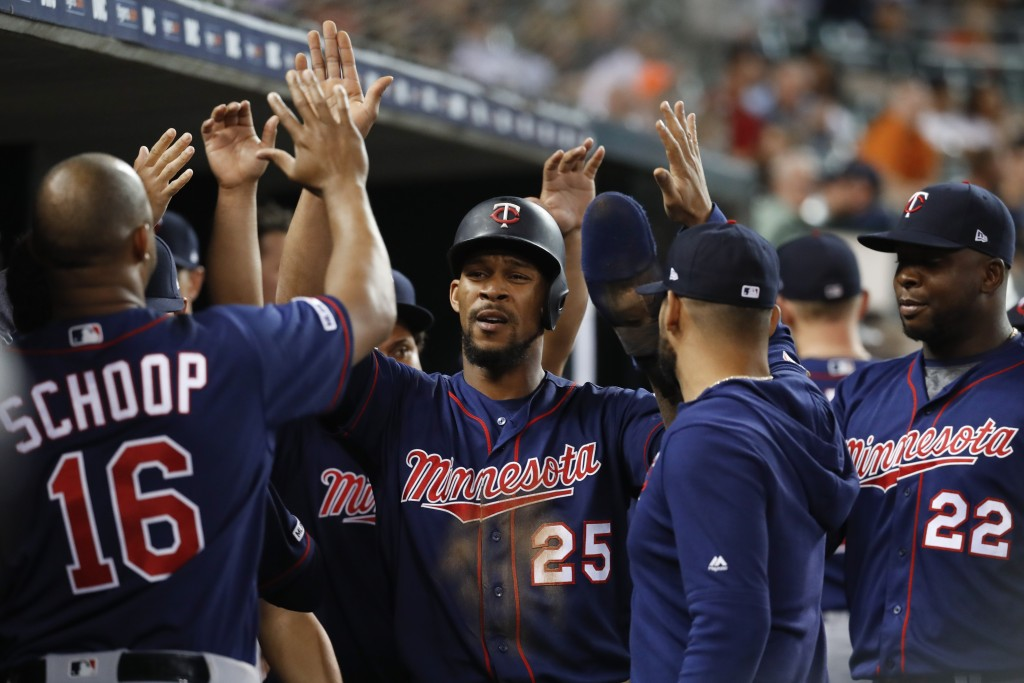Minnesota Twins' Byron Buxton (25) celebrates scoring in the ninth inning of the team's baseball game against the Detroit Tigers in Detroit, Friday, J