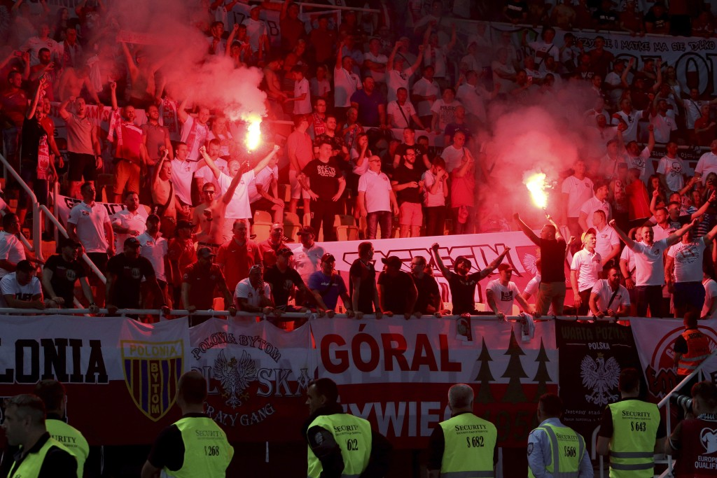 Poland's fans celebrate after their team scored against North Macedonia, during the Euro 2020 group G qualifying soccer match between North Macedonia ...