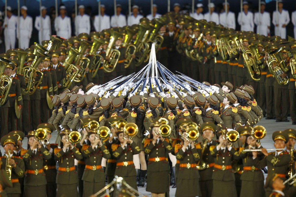 """In this Friday, June 7, 2019, file photo, female brass band members perform """"The Land of the People"""" during the mass games at the May Day Stadium in P"""