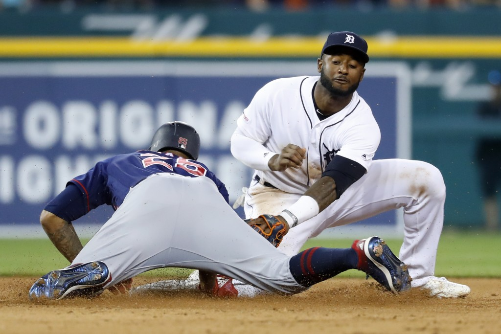 Minnesota Twins' Byron Buxton (25) slides into second base for a double under the tag of Detroit Tigers second baseman Ronny Rodriguez during the nint