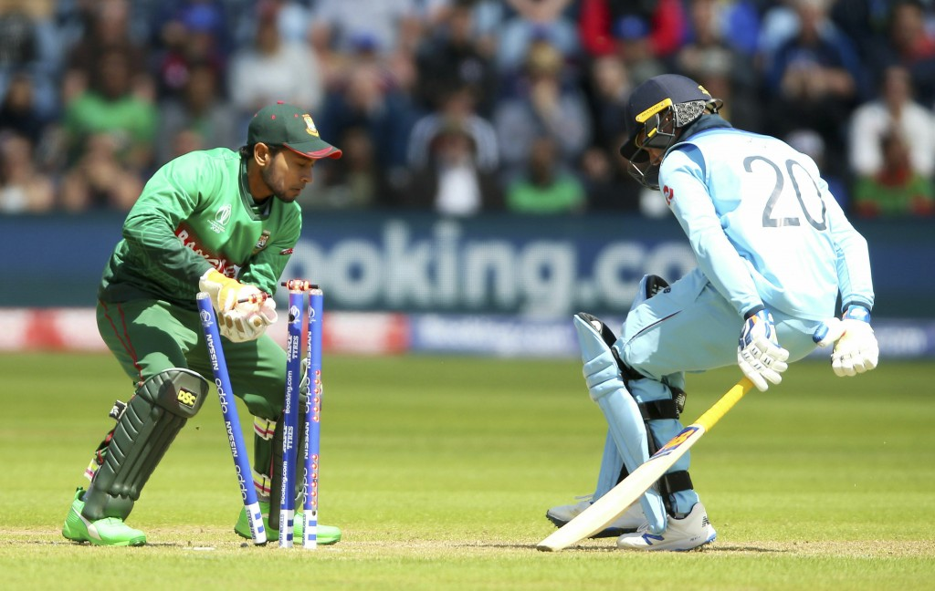England's Jason Roy, right, survives a run out appeal during the ICC Cricket World Cup group stage match between England and Bangladesh at the Cardiff
