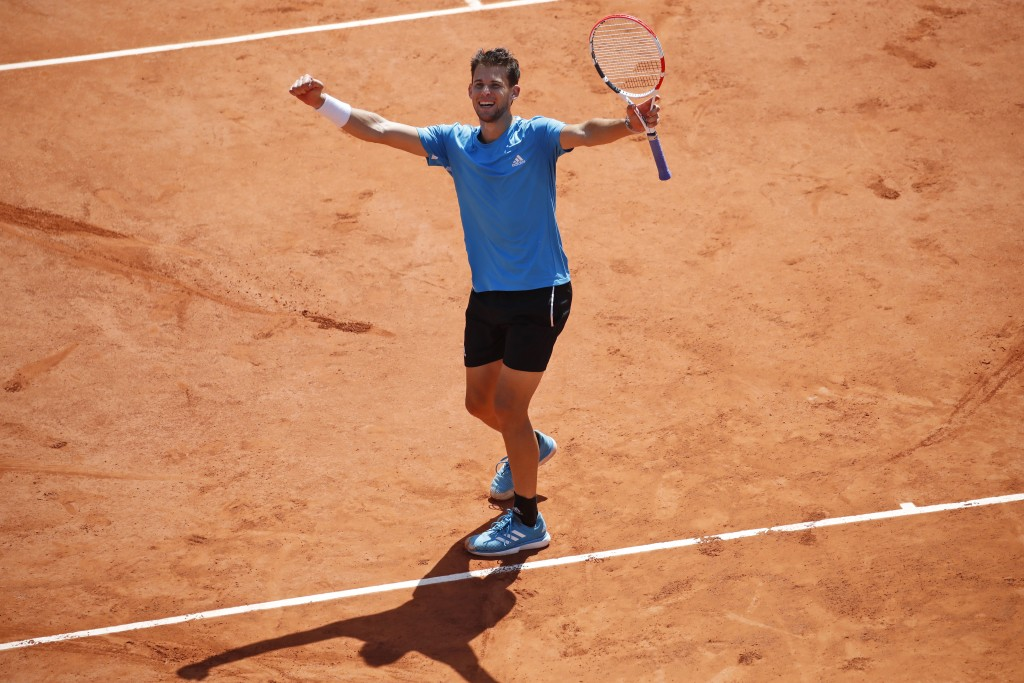 Austria's Dominic Thiem celebrates winning his semifinal match of the French Open tennis tournament against Serbia's Novak Djokovic in five sets, 6-2,...