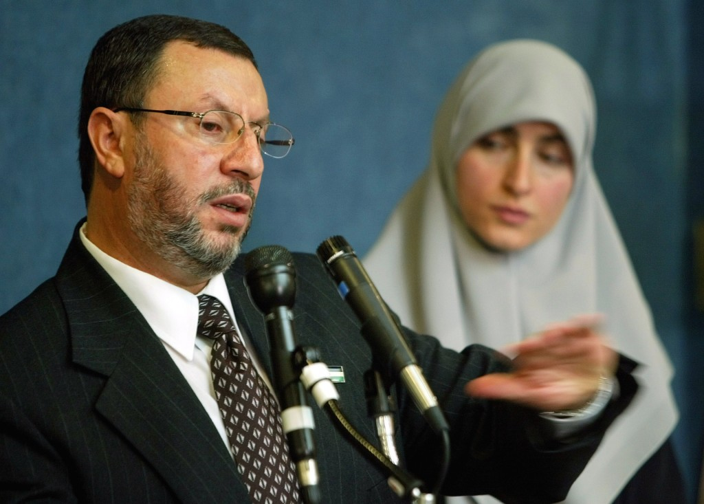 FILE - In this Feb. 16, 2004 file photo,  Abdelhaleem Ashqar, left, with his wife Asma, right, meets reporters at the National Press Club in Washingto
