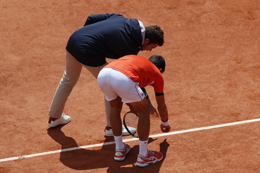 Serbia's Novak Djokovic argues over a line call during his semifinal match of the French Open tennis tournament against Austria's Dominic Thiem at the...