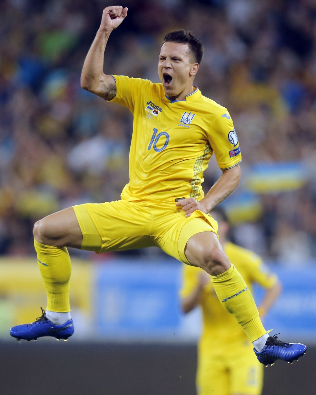 Ukraine's Yevhen Konoplyanka celebrates after scoring his side's fifth goal during the Euro 2020 group B qualifying soccer match between Ukraine and S...