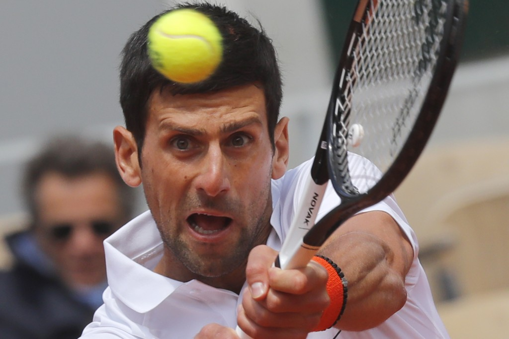 Serbia's Novak Djokovic plays a shot against Austria's Dominic Thiem during their men's semifinal match of the French Open tennis tournament at the Ro...