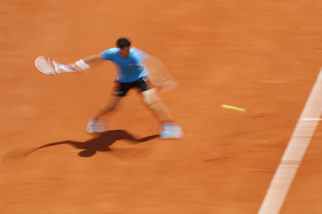 Austria's Dominic Thiem plays a shot against Serbia's Novak Djokovic during the men's semifinal match of the French Open tennis tournament at the Rola...