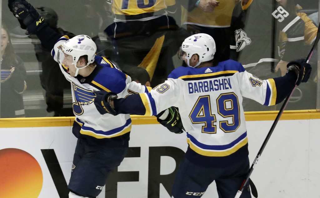 FILE - In this Feb. 10, 2019 file photo, St. Louis Blues right wing Vladimir Tarasenko, of Russia, left, celebrates with Ivan Barbashev (49), of Russi