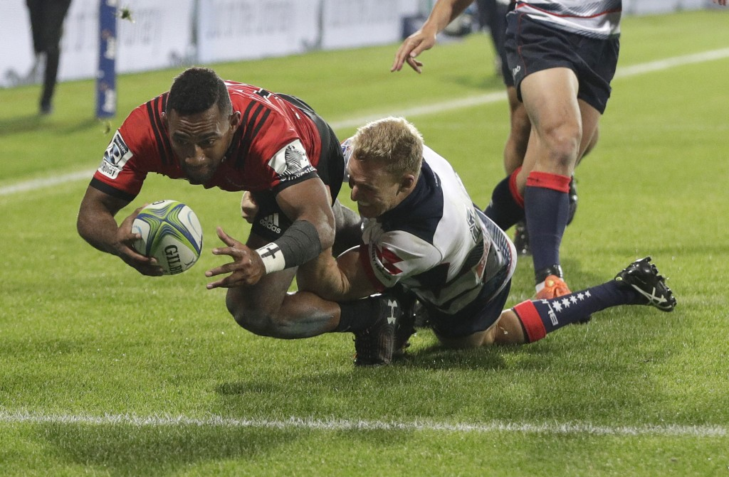 Crusaders Sevu Reece dives over in the tackle of Melbourne Rebels' Reece Hodge to score a try during the Super Rugby match between the Crusaders and t